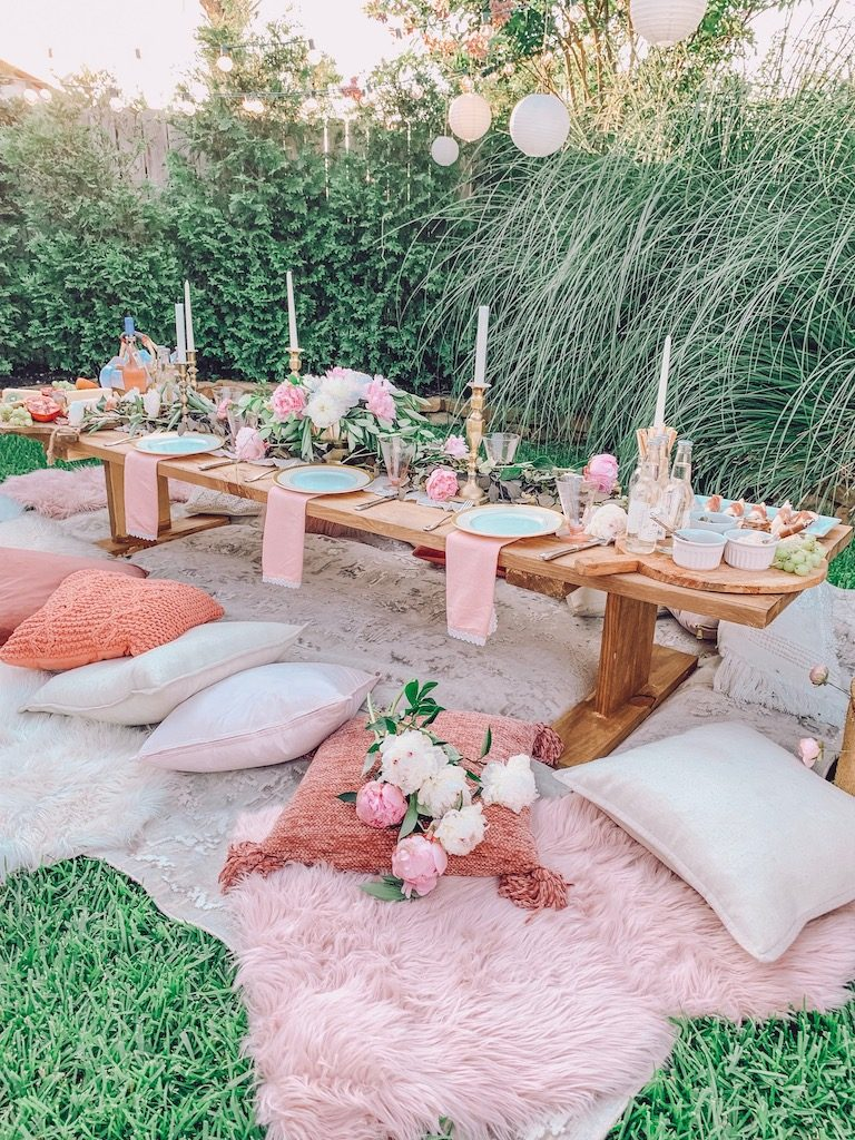 outdoor summer tablescape with pink touches
