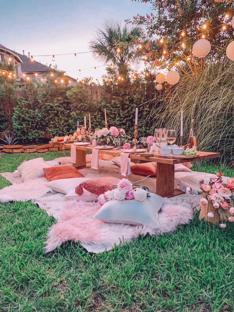 outdoor summer party with pillows for seating