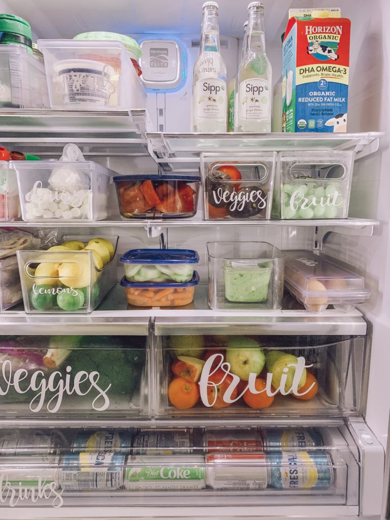 organize fridge with clear plastic bins and labels