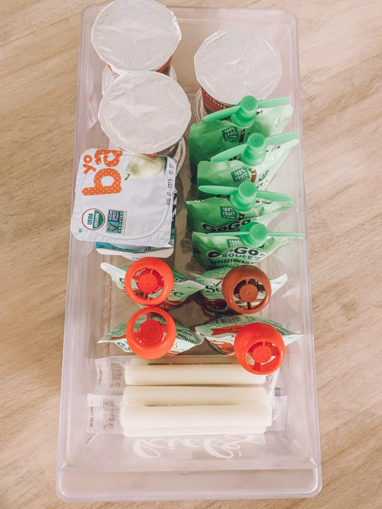 snacks for kids in the fridge - applesauce, yogurt, cheese sticks