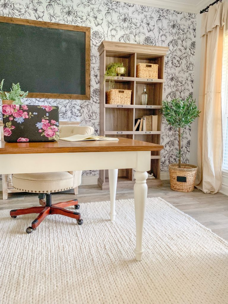 a modern farmhouse office with black and white removable wallpaper