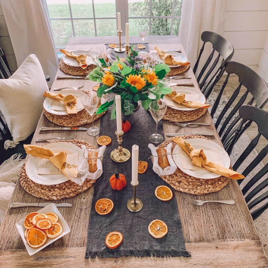 tablescape with dried oranges and mustard yellow