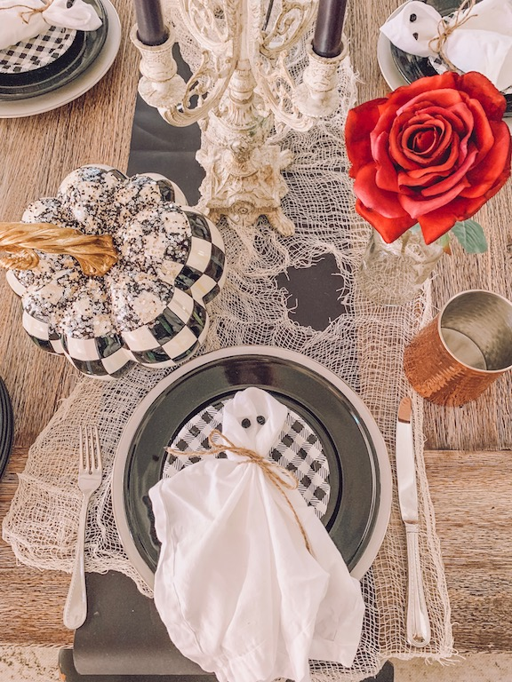 halloween table setting with ghost napkins