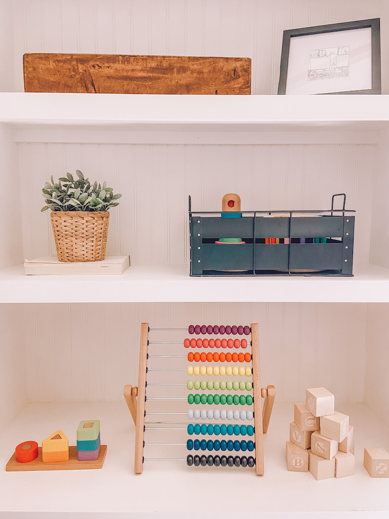 how to style a modern nursery bookshelf