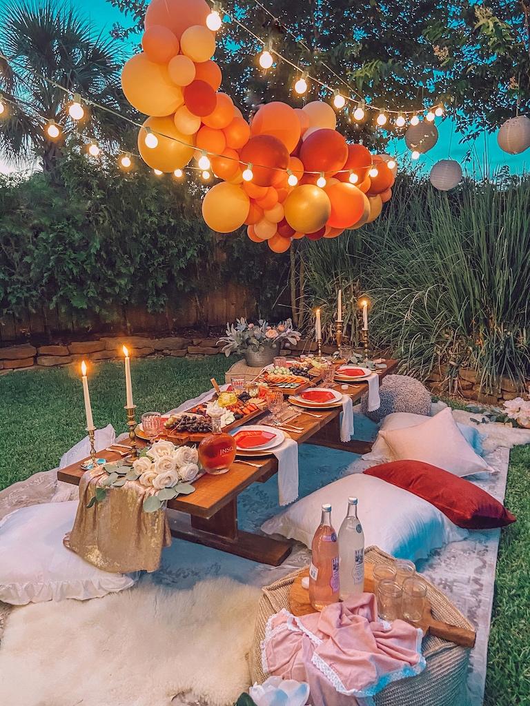 backyard bohemian dinner party balloon garland